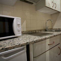 Отель Aparto Suites Muralto удобства в номере