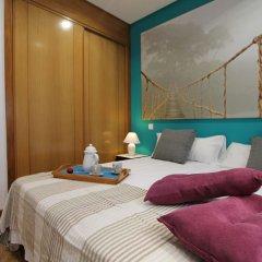 Отель Apartamentos Conde Duque DecÓ Испания, Мадрид - отзывы, цены и фото номеров - забронировать отель Apartamentos Conde Duque DecÓ онлайн комната для гостей фото 2