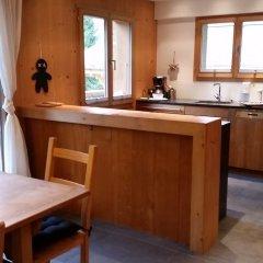 Апартаменты Gstaad Perfect Winter Luxury Apartment в номере
