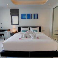 Отель Absolute Twin Sands Resort & Spa сейф в номере