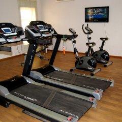 Отель Grand Inn & Suites фитнесс-зал фото 2