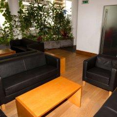 Отель Comfort Inn Ponta Delgada Португалия, Понта-Делгада - отзывы, цены и фото номеров - забронировать отель Comfort Inn Ponta Delgada онлайн интерьер отеля