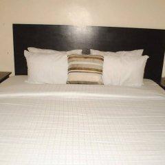 Отель Paconsu Suites Калабар комната для гостей