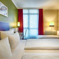 Leonardo Hotel & Residenz München комната для гостей фото 6