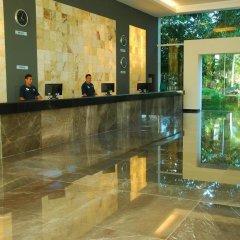 Отель Oasis Palm Hotel Мексика, Канкун - 9 отзывов об отеле, цены и фото номеров - забронировать отель Oasis Palm Hotel онлайн интерьер отеля