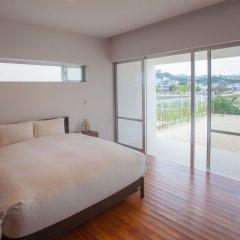 Отель Kariyushi Condominium Resort Onna Maeda Base Центр Окинавы комната для гостей фото 3