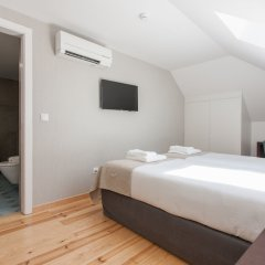 Отель Feels Like Home Rossio Prime Suites Лиссабон сейф в номере