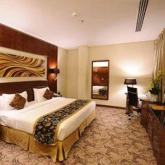Отель Al Hamra Palace By Warwick комната для гостей фото 2