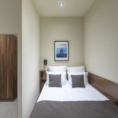 Гостиница Gregory Urban комната для гостей