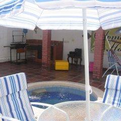 Отель Colombian Home Hostel Cali Колумбия, Кали - отзывы, цены и фото номеров - забронировать отель Colombian Home Hostel Cali онлайн бассейн фото 3