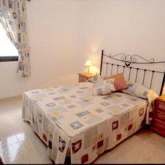 Отель Cala Apartments 3Pax 1D Испания, Гинигинамар - отзывы, цены и фото номеров - забронировать отель Cala Apartments 3Pax 1D онлайн комната для гостей фото 2
