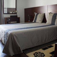 Hotel Portas De Santa Rita сейф в номере