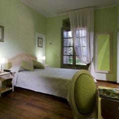Отель Relais Corte Cavalli Понти-суль-Минчо комната для гостей