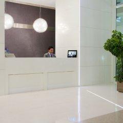 Отель Nassima Tower Hotel Apartments ОАЭ, Дубай - отзывы, цены и фото номеров - забронировать отель Nassima Tower Hotel Apartments онлайн интерьер отеля фото 3