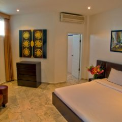 Апартаменты Mosaik Apartment Паттайя комната для гостей фото 3