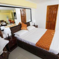 Отель SDR Mactan Serviced Apartments Филиппины, Лапу-Лапу - отзывы, цены и фото номеров - забронировать отель SDR Mactan Serviced Apartments онлайн комната для гостей фото 2