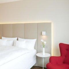 Отель NH Collection Frankfurt City 4* Улучшенный номер с различными типами кроватей фото 13