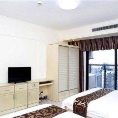 Апартаменты Xingfu Huafu Apartment удобства в номере