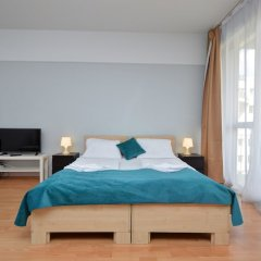 Апартаменты Agape Apartments комната для гостей фото 12