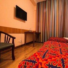 Отель Tagaitai Guest House Кыргызстан, Каракол - отзывы, цены и фото номеров - забронировать отель Tagaitai Guest House онлайн удобства в номере