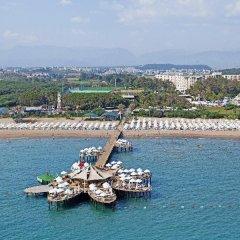 Sueno Hotels Beach Side Турция, Сиде - отзывы, цены и фото номеров - забронировать отель Sueno Hotels Beach Side онлайн приотельная территория фото 2