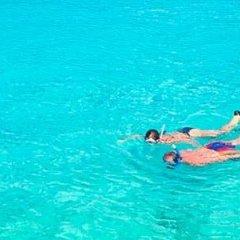 Отель JW Marriott Cancun Resort & Spa Мексика, Канкун - 8 отзывов об отеле, цены и фото номеров - забронировать отель JW Marriott Cancun Resort & Spa онлайн приотельная территория фото 2