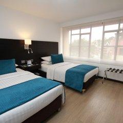 Отель Dann Cali Колумбия, Кали - отзывы, цены и фото номеров - забронировать отель Dann Cali онлайн комната для гостей