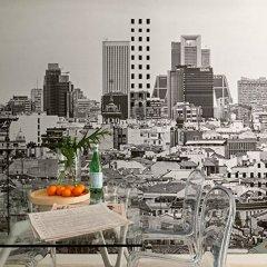 Отель Eric Vökel Boutique Apartments - Atocha Suites Испания, Мадрид - отзывы, цены и фото номеров - забронировать отель Eric Vökel Boutique Apartments - Atocha Suites онлайн приотельная территория