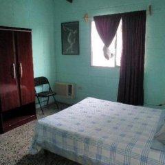 Отель Guesthouse Dos Molinos Сан-Педро-Сула комната для гостей фото 5