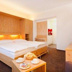 Отель Central Swiss Quality Apartments Швейцария, Давос - отзывы, цены и фото номеров - забронировать отель Central Swiss Quality Apartments онлайн комната для гостей фото 4