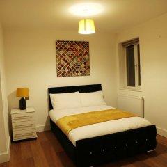 Апартаменты Cosy Stay Apartments сейф в номере