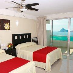 Отель Las Flores Beach Resort комната для гостей фото 4