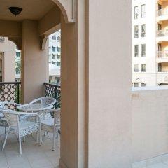 Отель One Perfect Stay - 2BR at Zanzabeel 3 балкон