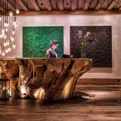 Отель The Alpina Gstaad Швейцария, Гштад - отзывы, цены и фото номеров - забронировать отель The Alpina Gstaad онлайн интерьер отеля
