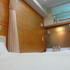 Отель Kunming house комната для гостей