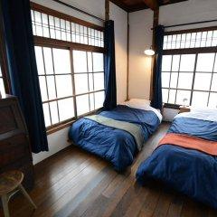 Taketa station hostel cue Минамиогуни комната для гостей фото 5
