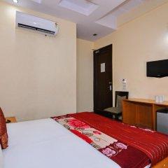 Отель OYO 5943 TJS Grand удобства в номере