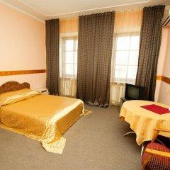Гостиница Atrium Николаев комната для гостей фото 4