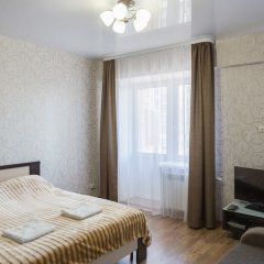 Гостиница Comfort Apartment on Stroitelny per 8 в Иркутске отзывы, цены и фото номеров - забронировать гостиницу Comfort Apartment on Stroitelny per 8 онлайн Иркутск комната для гостей фото 2