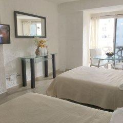 Отель Cancun Plaza Condo комната для гостей фото 3