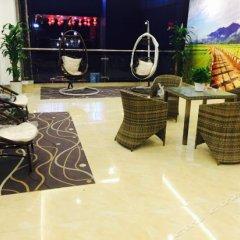 Отель 7 Days Premium (Chongqing Fuling Binjiang Avenue) Китай, Фулинь - отзывы, цены и фото номеров - забронировать отель 7 Days Premium (Chongqing Fuling Binjiang Avenue) онлайн интерьер отеля фото 2