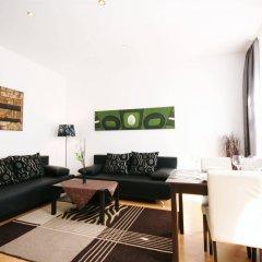 Отель Vienna CityApartments - Premium Apartment Vienna 1 Австрия, Вена - отзывы, цены и фото номеров - забронировать отель Vienna CityApartments - Premium Apartment Vienna 1 онлайн комната для гостей фото 3
