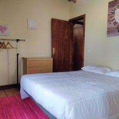 Отель A Casinha de Santa Cruz Санта-Крус комната для гостей фото 4
