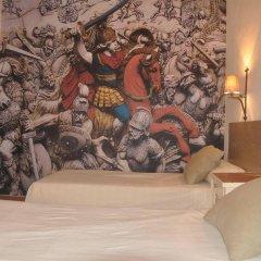 Отель Hostal Temático El Cid Испания, Фуэнхирола - отзывы, цены и фото номеров - забронировать отель Hostal Temático El Cid онлайн комната для гостей фото 3