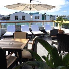 Отель Coconut Tree Hulhuvilla Beach Мале гостиничный бар