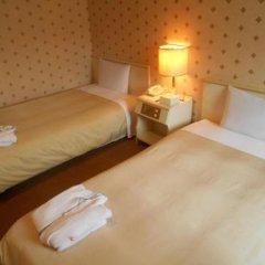 Отель Bougainvillea Shinjuku Япония, Токио - отзывы, цены и фото номеров - забронировать отель Bougainvillea Shinjuku онлайн комната для гостей фото 5