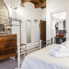 Апартаменты Santa Croce Apartment Флоренция комната для гостей фото 5