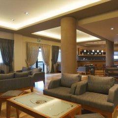Отель Blue Dolphin Hotel Греция, Метаморфоси - отзывы, цены и фото номеров - забронировать отель Blue Dolphin Hotel онлайн интерьер отеля фото 3