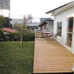 YADO ZERO ONE - Hostel Фукуока балкон
