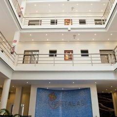 Hotel Quatro Pétalas интерьер отеля